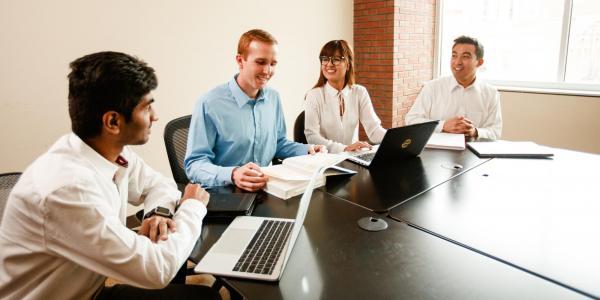 cu denver business students on computer